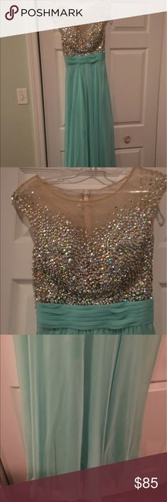 Mint green prom dress size 2 ! Only worn once. Size 2, 57 inches from shoulder to hem. Dresses Prom
