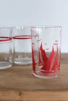 Vintage juice glasses featuring a sail boat and stripes.