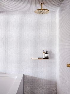 minimalist modern bathroom decor with tiny tiles and gold detail