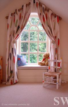 Inspiration for dressing an arched window. Eyelet curtains on an angled wooden pole.