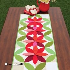 """Extra Orange Peel patches add dimension to this table runner made with GO! Orange Peel-4 1/2"""" (55455) and GO! Square-5"""" (4 1/2"""" Finished) (55010). Fabrics are Soho Solids provided by Timeless Treasures."""