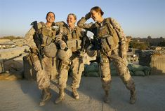 Sgt. Sheena Adams, 25, and Lance Corporal Kristi Baker, 21, and Hospital Corpsman Shannon Crowley, 22, US Marines with the FET 1st Battalion 8th Marines, Regimental Combat team II pose at their forward operating base on Nov. 17, 2010 in Musa Qala, Afghanistan.