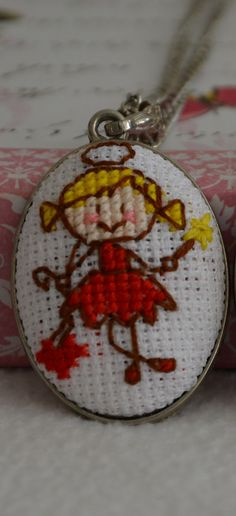 Angel cross stitch necklace by ezgidesign on Etsy