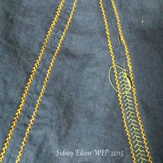 Sidney Eileen's gorgeous seam treatment on a Viking linen apron dress. The thread on Facebook contains some other links to Viking-era embroidery patterns and techniques, some of which are quite lovely.