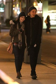 Lily Collins and Jamie Campbell Bower are all smiles and affectionate while going for a late night walk in Toronto, Canada.