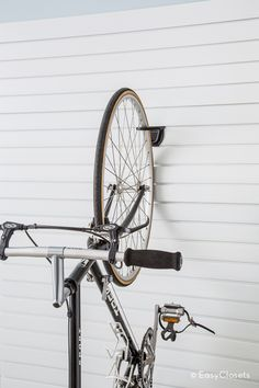 Wall storage for bikes is a great way to save floor space in the garage and still keep bikes in easy reach.