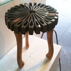 Sweet end table made from Hults Bruk forged hatchets.