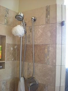"Designed this shower for Kate (can't remember her last name) while I was at CCTile & Remodeling- Cut down 18""x18"" Desert Sand Travertine to 9""x18"" and put two rows of 1""x2"" Golden Scabos Travertine in between every 9"" side possible. Other pictures to follow."