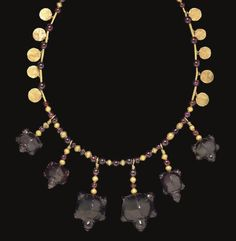 A WESTERN ASIATIC GOLD AND GARNET BEAD NECKLACE  CIRCA LATE 1ST MILLENNIUM B.C.
