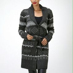 Full length sweater 100% acrylic. Please note model is wearing a size small. Also available in Small and Large. Moon Collection Sweaters Cardigans
