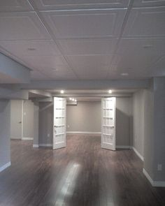 Basement remodel  Photo posted by Crystal Clear Home Renovations located in Oshawa Love the open layout, gray paint, floors but not the ceiling tiles...want soundproof tiles with different design!
