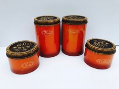 Excited to share this item from my #etsy shop: Vintage Orange Metal Canister Set of Four Burlington Canisters with Plastic, Faux Wood, Embossed Fruit Lids, Flour, Sugar, Coffee, Tea #orange #wedding #brown #vintagecanisterset #burlingtoncanisters #fruitcanisterset #rarecanisterset #collectiblecanister #vintagekitchen