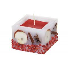 Paraffin candle with embedded decorative elements. Made by Neo-Spiro.