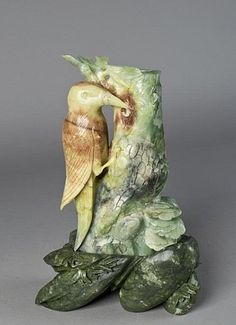 """Chinese Jade Carving of Bird and Bamboo -  finely carved to depict a bird on bamboo stalk brush holder with custom carved jade stand with foliage, 12.75""""H X 8.25""""W including the stand circa 20th century."""