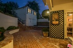 Additionally, there is a separate, permitted guest house with a full bathroom and its own entrance, which would make a perfect studio or work space.