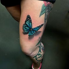 What are some realistic butterfly tattoo designs?