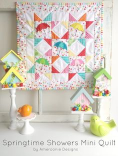 Amy from Ameroonie Designs is back with us today sharing a free Springtime Showers Mini Quilt Pattern. It's bright and cheery and just what I needed on this dreary, rainy day! If you don't want to mak