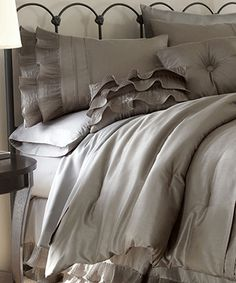 Bedding with Frilly Accents - Love the neutral color and ruffles