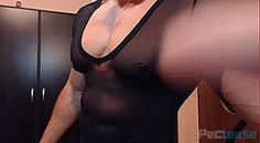 Skywalker00 showing off his pecs in a tight black v-neck.