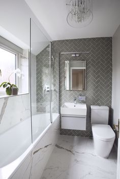 Small bathroom does not have to be boring. One of my favorite bathroom projects! … Small bathroom doesn't need to be boring. One of my favourite bathroom projects! Love the combination of herringbone and marble effect tiles in this bathroom, which togethe Gray And White Bathroom, Bathroom Interior Design, Bathroom Makeover, Shower Room, Modern Bathroom, Bathroom Renovations, Bathroom Design Small, Luxury Bathroom, Tile Bathroom