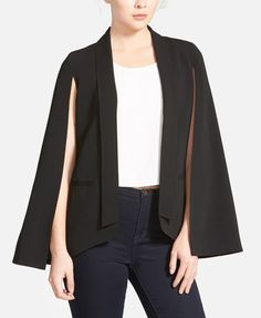 This fluttery, feminine take on the staple blazer is spliced at the sleeves for a cape-like finish.