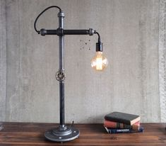 Go back to the chemistry lab environment directly from your workspace with this Industrial Style Work Light by Peared Creation.