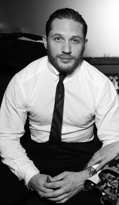 Tom Hardy. I don't even now why I like this picture so much...   he just gives off that warm, cozy, safe feeling... like a home. I don't know... :-D