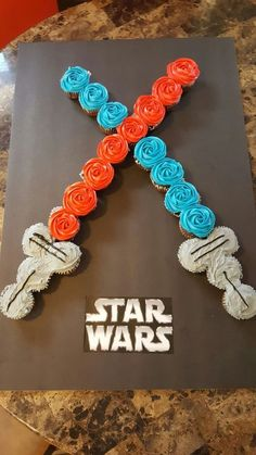 May the Force be with you! Star wars Light Saber cupcake cake