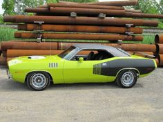 1971 Plymouth Cuda 426 HEMI curious yella the only color to have been banned  (in the state of montana) if you ever been around  a car painted this color on abright sunny day...you know why