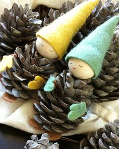 Pine cone babies...too cute! Kids can do this find the faces by the bag at Michaels cut the hands felt ,make cone hats glue together . Add glitter to hats or cones ! Mobile or ornament with fishing wire .