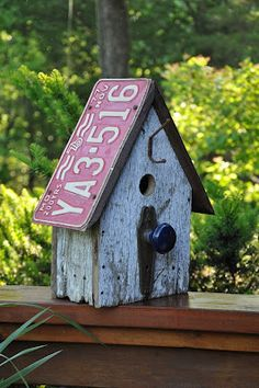 This site has lots of cute bird houses & feeders. This one has old wood, vintage license plate, & old hardware. Rebecca's Bird Gardens: