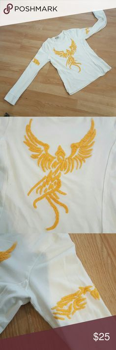 People4Peace long sleeve top Long sleeve white cotton top with yellow angel embroidery on front emdroindery around arm and cute  peaceful dove on the back bottm corner . . By People4Peace . Super fun peaceful top . Great with jeans , a denim vest  and converse high tops . People4Peace Tops Tees - Long Sleeve