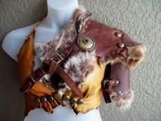 The work on this is beautifully executed.   Forsworn Shoulder Armor burning man tribal door ArchaicLeatherworks