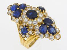 Prachtvoller Saphir-Brillant-RingGelbgold 750. Reich ausgefasst mit 9 feinen Saphiren und Brill. zus — Schmuck
