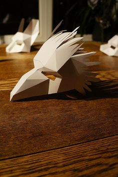 These plans and instructions enable you to make your own half face Bird mask from cardboard. These templates are for a half face mask. Game Of Thrones Mask, Skull Mask, Fox Mask, Cardboard Mask, Geometric Bird, Bird Costume, Tribal Costume, Bird Masks, Animal Masks