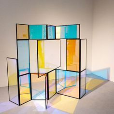 """This folding screen entitled """"And A And Be And Not"""" by Berlin-based designer Camilla Richter is made from different color transparent sections, which change color according to the light and where you're standing when you look at it. Part of [D3] Design Talents at imm cologne."""