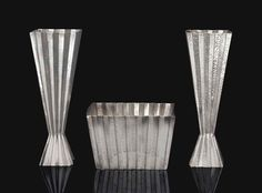 JOSEF HOFFMANN (1870-1956) A PAIR OF VASES AND A CENTERPIECE, CIRCA 1920 hammered and pleated silver each vase: 8¼ in. (21 cm.) high, box: 3½ in. (3.9 cm.) high, 5¼ in. (13.4 cm.) square each piece stamped with Josef Hoffmann and Wiener Werkstätte monograms, the centerpiece and one vase stamped with rose trademark, the centerpiece additionally stamped Wiener Werkstatte Made in Austria Art Deco, Art Nouveau, Joseph Hoffman, Streamline Art, Koloman Moser, Vienna Secession, Messing, Art And Architecture, Midcentury Modern