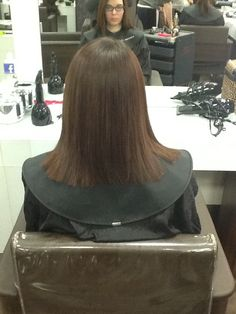 This was the back of the lady's hair after I done a one length hair cut with square layers I finished it off by straightening it