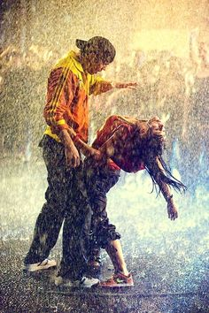 Dancing in the rain couples rain city outdoors street dance
