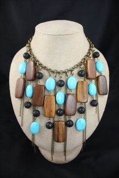 Waterfall Necklace created with turquoise ovals, lava stone rounds, and rectangle wood beads
