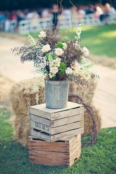 Crates with the metal pail and flowers - could have some more roughly arranged milk pails or buckets around the venue. I like the purplish / brown grasses coming in here.