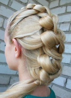 This is interesting, and I believe it would be very pretty with some white baby's breath for a wedding hairstyle.