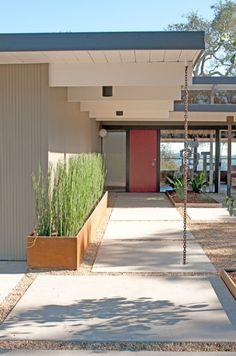 Nice midcentury exterior with japanese rain chain remodel