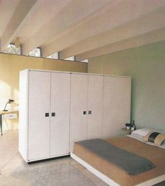 Ikea style wardrobes used as space divider in studio apartment.                                                                                                                                                                                 More