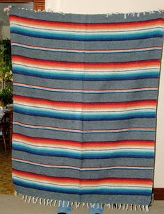 """Blanket Throw Mexican Southwest 56x74""""  Fringed Rio Bravo style GRAY A large quality blanket which is gray with bright rainbow colored stripes.  Fringed at top and bottom. Use it as a couch throw, a picnic blanket or a seat cover for your car or truck. #mexicanblanket #blanket #throw"""