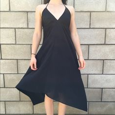 Black chiffon halter high low asymmetrical dress A beautiful high low dress. New never worn. No tags. Zips up the back and has a halter tie behind the neck. It is chiffon but it is also fully lined and is not see through. Dresses Asymmetrical
