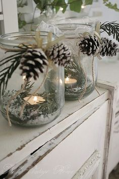 jars with greenery and candles