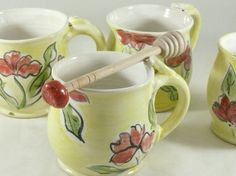 Perfect for someone who loves flowers and artistic designs, this handmade ceramic cup is a beautiful work of art as well as functional pottery. I made the decorative mug on my pottery wheel out of durable white stoneware clay and used a majolica-style decoration to paint on the poppy flower design right into the glaze for durability. This cup is a perfect size for a nice cup of tea or coffee, and works well for soups or cereal.  The teacup holds around 12 - 14 ounces of liquid and is 3.5…