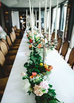 Full floral runners lining on the long banquet table.