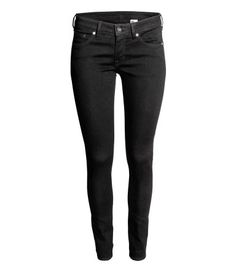 Black denim. 5-pocket, low-rise jeans in washed superstretch denim with skinny legs.